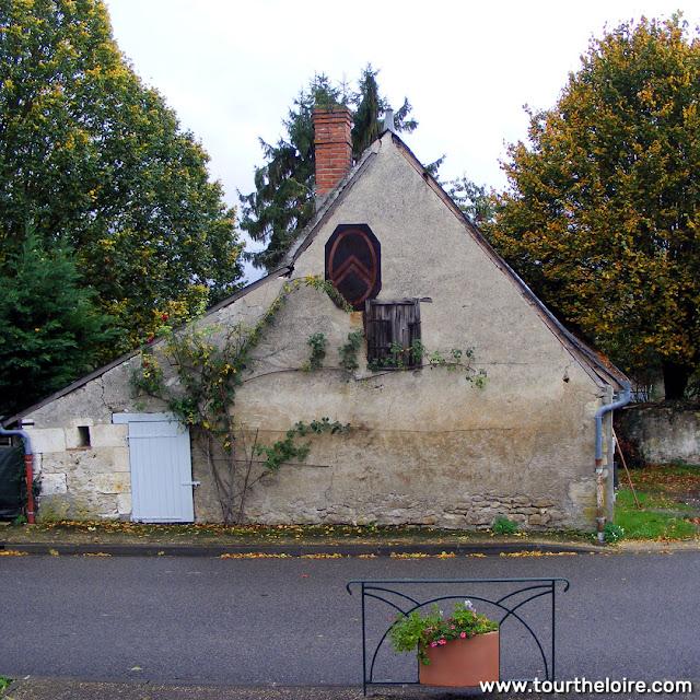 Vintage Citroen sign on a building, Indre et Loire, France. Photo by Loire Valley Time Travel.