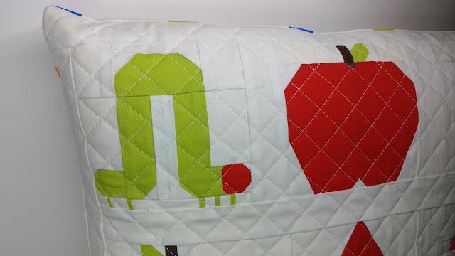Paper pieced caterpillar and apple quilt blocks