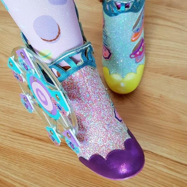 purple metallic toe of ankle boots with ferris wheel on side