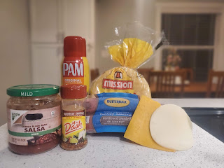recipe ingredients laid out on counter top: 2 slices cheese, corn tortillas, cooking spray, turkey sausage, salsa