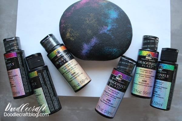 Painting a galaxy with stars and planets and the moon on a rock with hand lettered text diy instructions