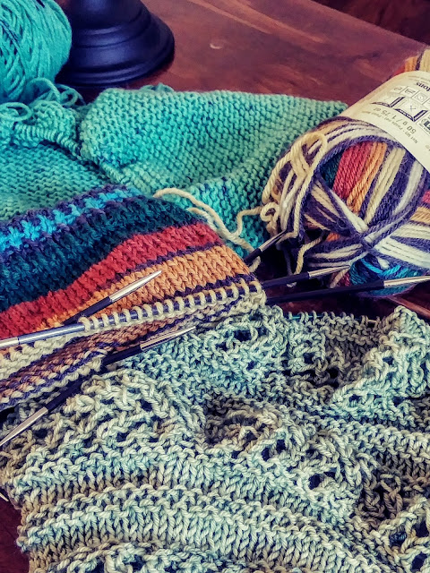 Using fingering weight yarn to knit a baby blanket, a sock and an oversized cowl