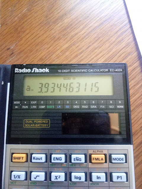 Radio Shack EC-4024 close up: Screen showing a calculation in progress