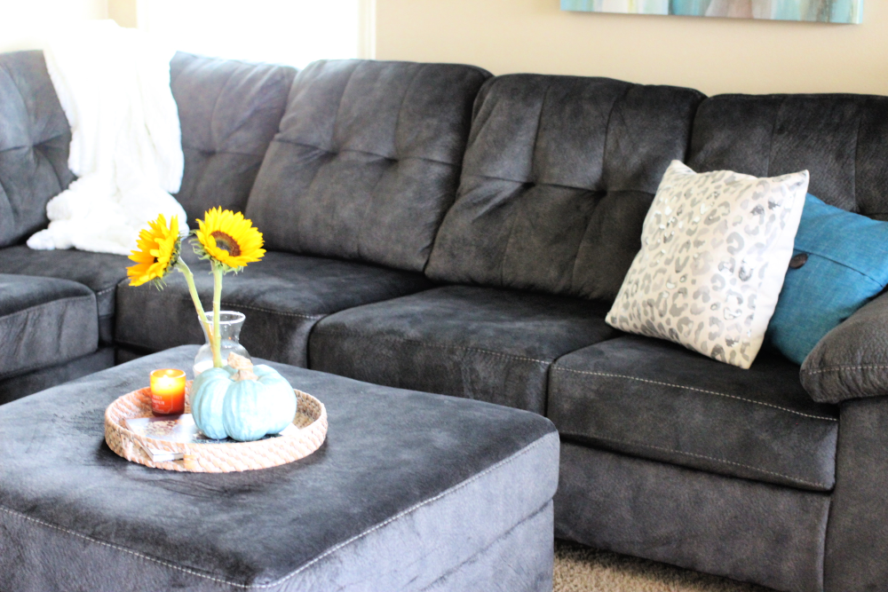 a sectional with an ottoman