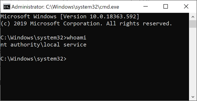 A command prompt, running whois and showing the use as Local Service.