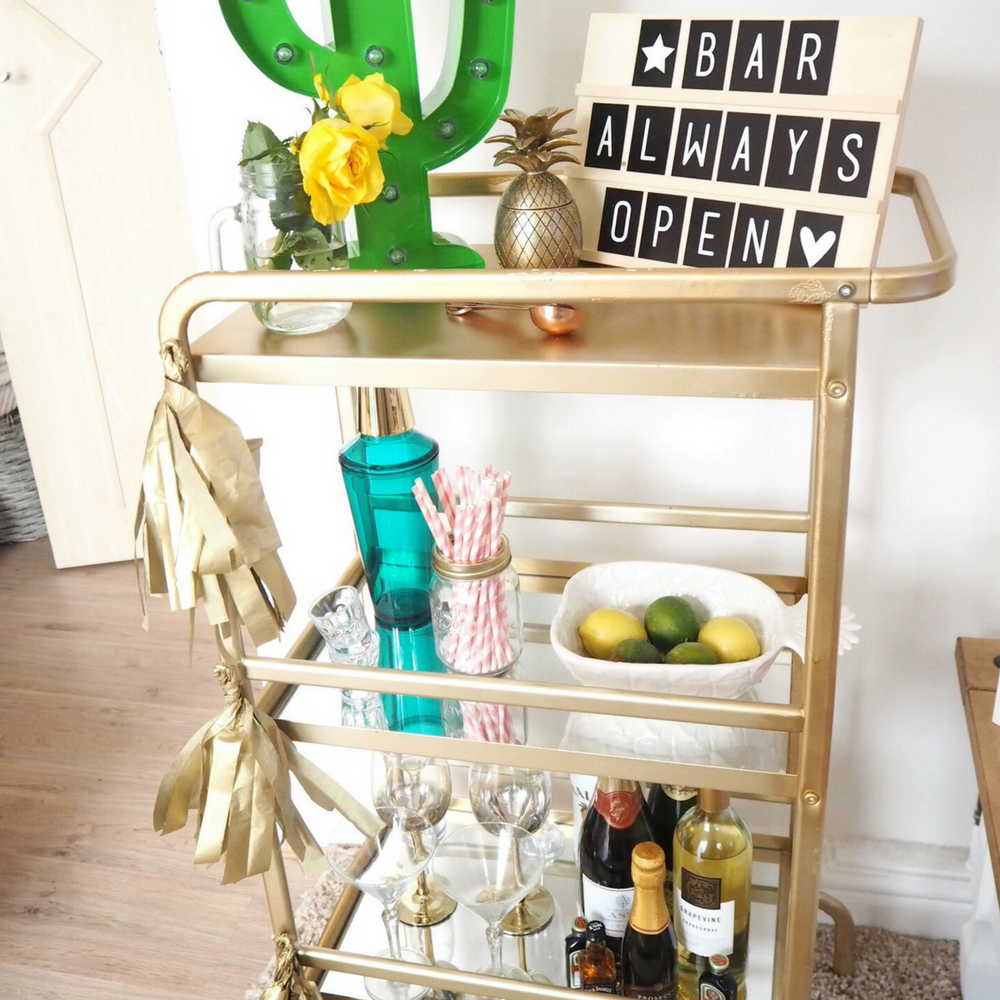 Sunnersta Ikea Hack DIY tutorial creating a drinks trolley bar cart using a Sunnersta trolley. Part of my summer garden budget makeover. Back yard decor home styling.