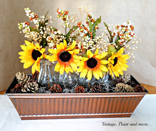 Vintage, Paint and more... DIY centerpiece donw with faux sunflowers in milk bottles, bleached pinecones and a copper trough