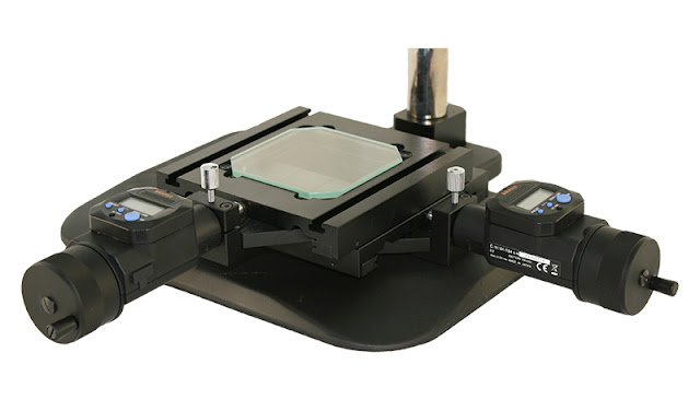 Microscope stage with digimatic indicators for making measurements.
