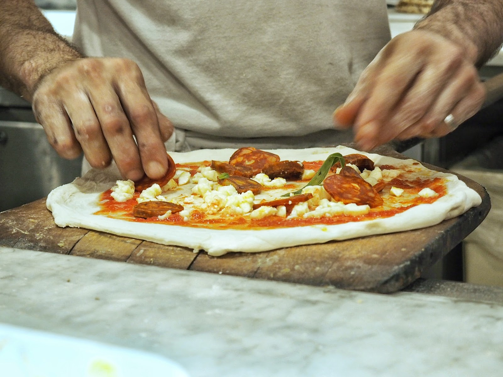 Franco Manca Chorizo sourdough pizza preperation