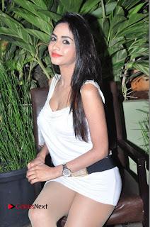 Actress Model Pooja Sri Stills in White Short Dress at F Club pre soft Launch  0115.JPG