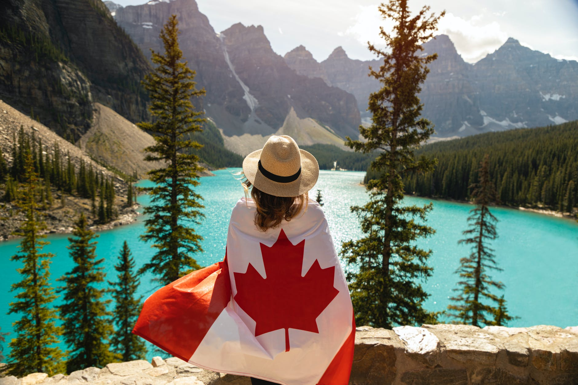 Canadian flag wrapped over a lady
