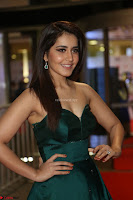 Raashi Khanna in Dark Green Sleeveless Strapless Deep neck Gown at 64th Jio Filmfare Awards South ~  Exclusive 107.JPG