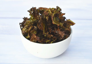 white bowl full of crispy kale chips