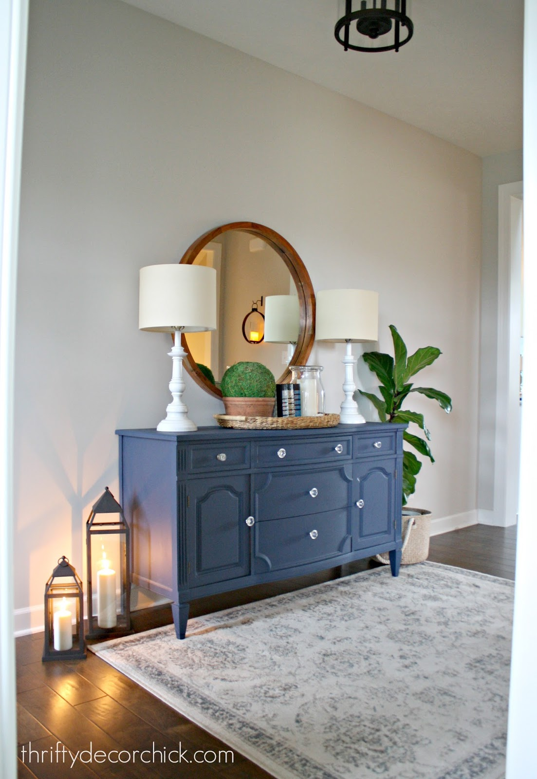 Long foyer with dresser and round mirror