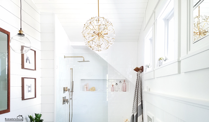 White bathroom with shiplap - gold fixtures and gray vanity