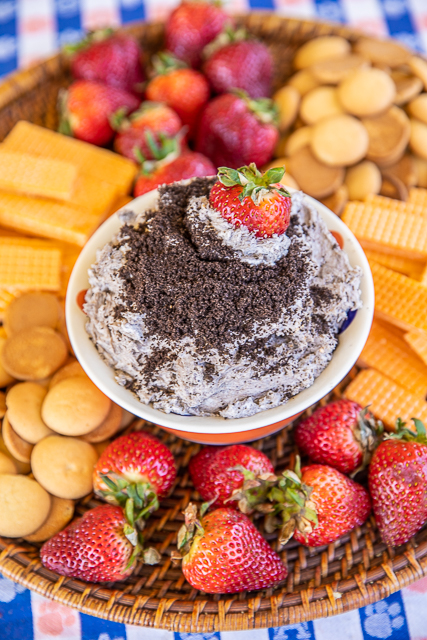 Oreo dip in a bowl with cookies and strawberries
