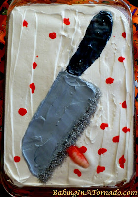Raspberry Swirl Halloween Cake, a moist white raspberry swirled cake with fluffy vanilla frosting, decorated for Halloween | Recipe developed by www.BakingInATornado.com | #recipe #cake #Halloween