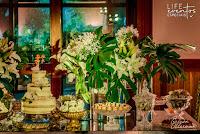casamento com cerimônia com missa no santuário mãe de deus em porto alegre e recepção no salão por-do-sol da aabb porto alegre com decoração simples e sofisticada elegante em verde e branco com detalhes em vidro com organização projeto e cerimonial de life eventos especiais
