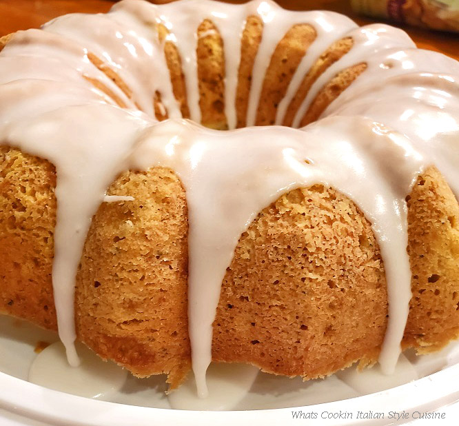 This is a bundt cake with a beautifully drizzled evenly white frosting all over it in little drips off the sides