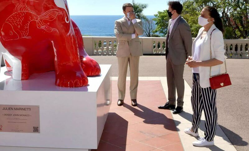 Princess Stephanie, Louis and Marie Ducruet at the inauguration of the sculpture of Doggy John. White jacket, striped pants, red bag
