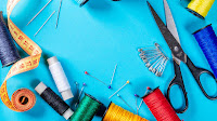 """Collection of attributes for embroidery and sewing on blue background"" by wuestenigel is licensed under CC BY 2.0"