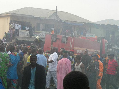 Inferno In Ekiti: See Photos Of Brave Gov. Fayose Leads Fire Fighters