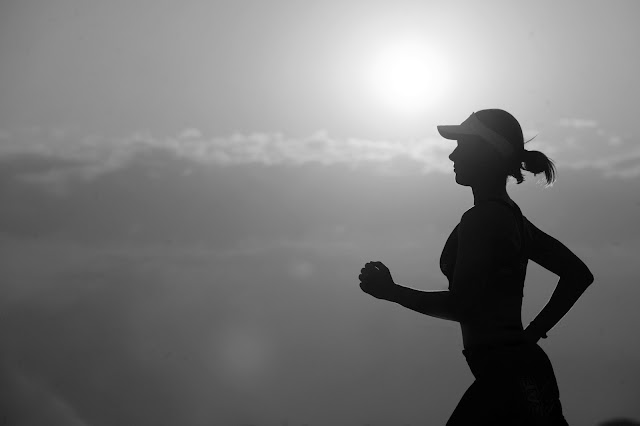 woman running in black and white