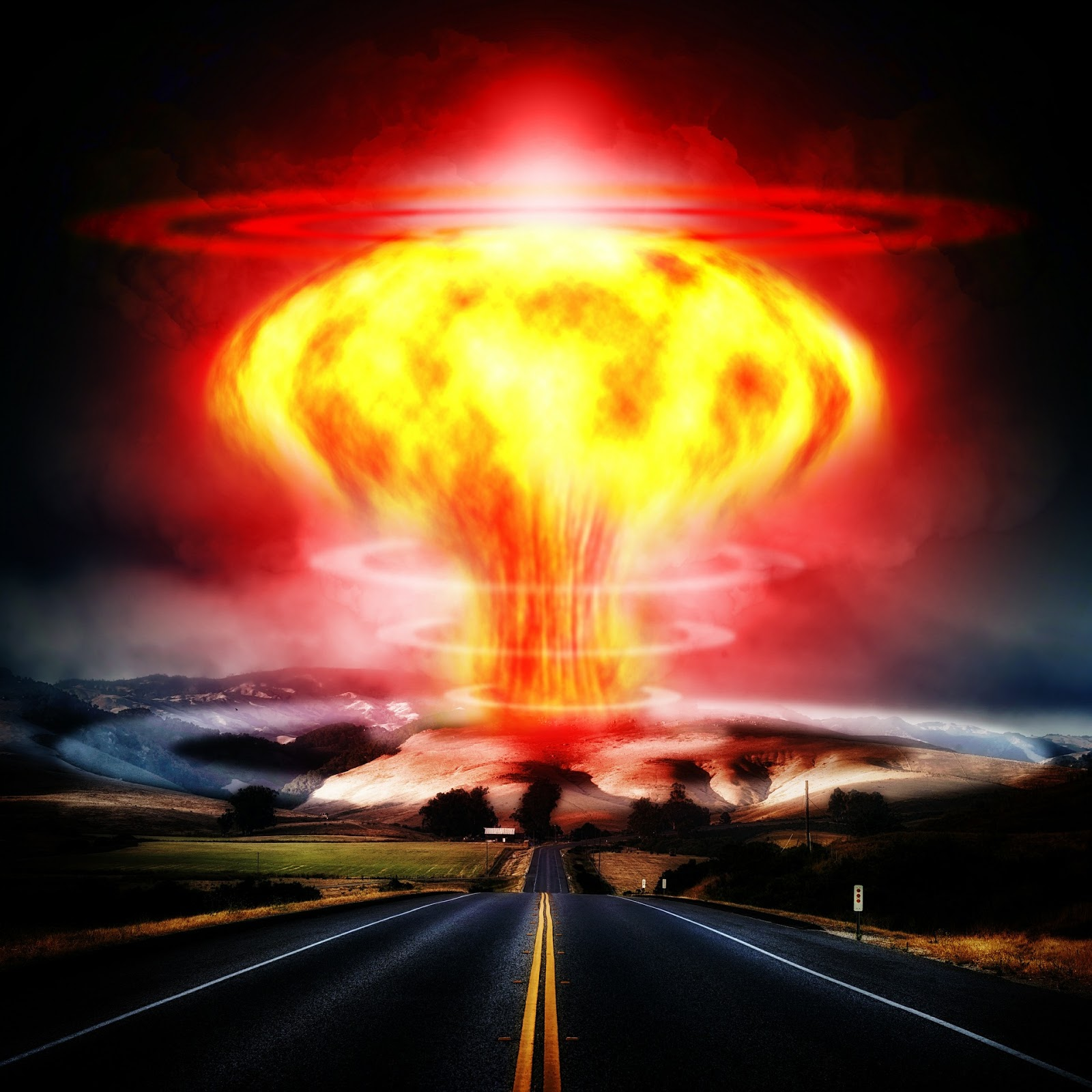 a deserted highway flows into the horizon with a nuclear explosion in the background to illustrate a blog post about bombs and the military