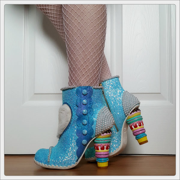 wearing Irregular Choice Bee Delicious blue glitter ankle boots