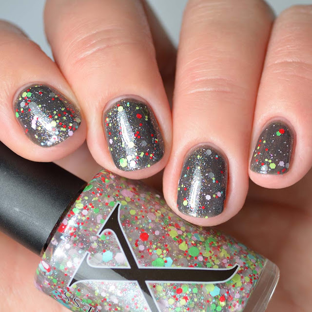 retro xmas glitter nail topper swatched over grey four finger swatch