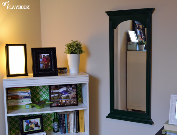 Hunter Green mirror next to bookcase