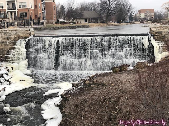 Winter framed waterfall at Leper Dam in Menomonee Falls.