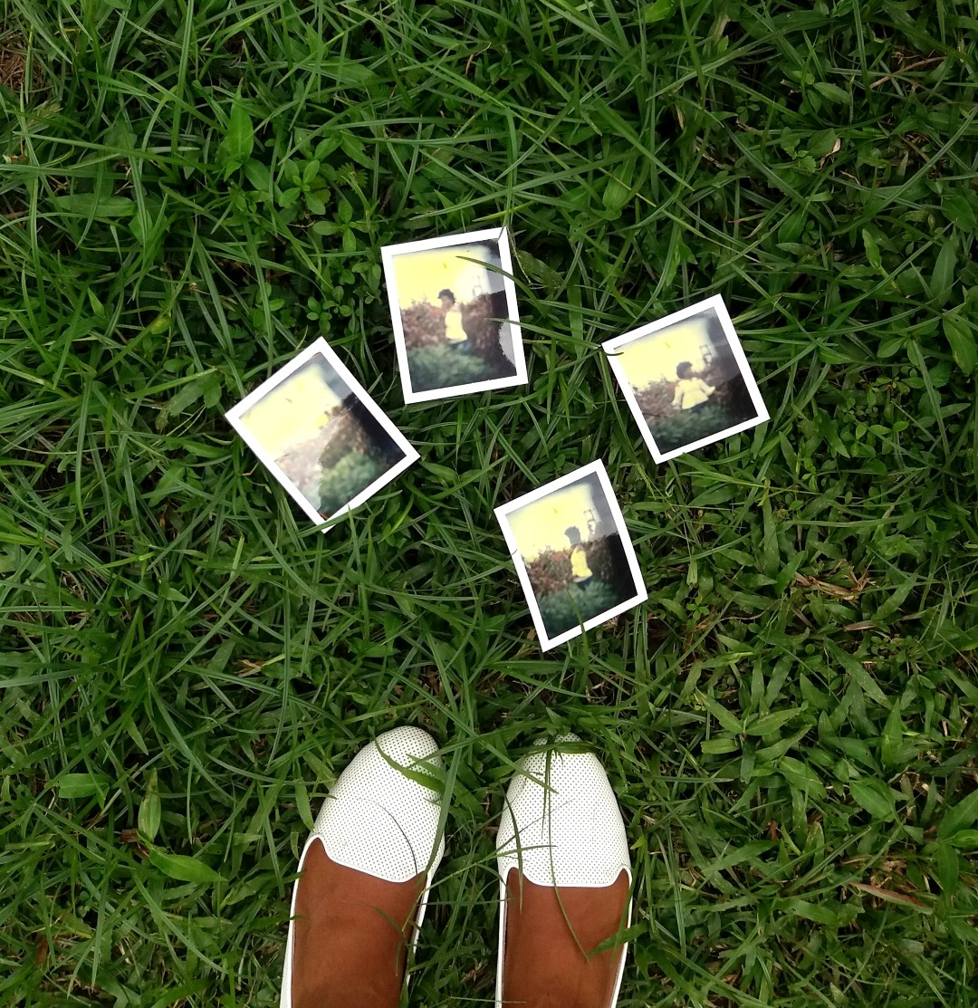 Polaroid Pictures On Grass And White Shoes