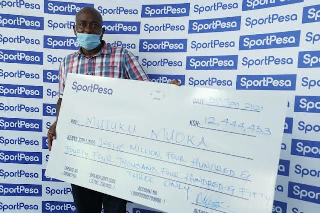 Businessman Mutuku Muoka jackpot cheque photo