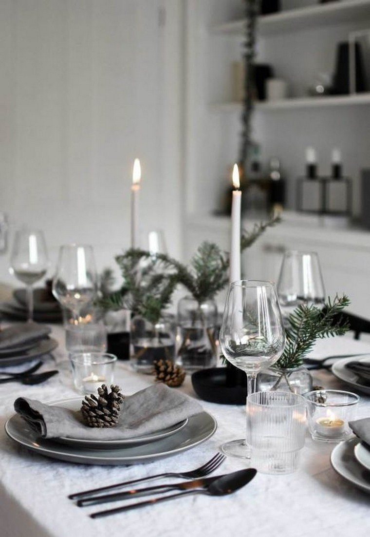 Minimalist Christmas table styling with fir, candles & pine cones