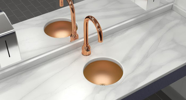Copper sink and faucet by Elkay