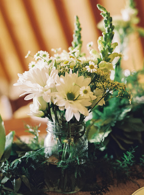 White and green florals for the barn reception at Jonna and Heather's Inn at West Settlement Wedding by Karen Hill Photography