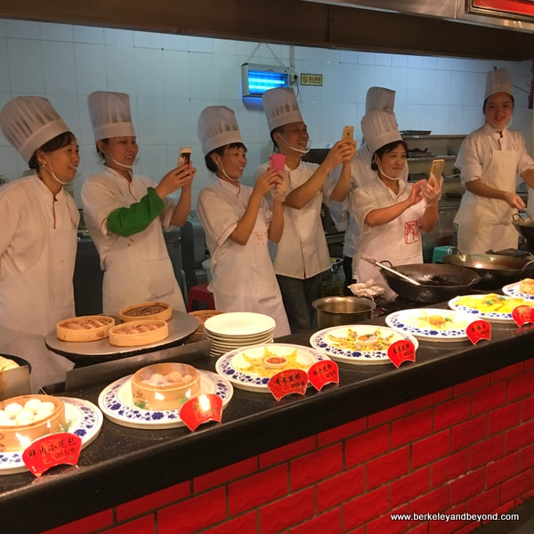 line of chefs taking photos at Tian Yi Jiao Restaurant in Wenzhou, China