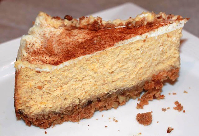 this is a slice of Amaretto Cheesecake that has pumpkin puree in the filling with a cracker sweet cinnamon crust