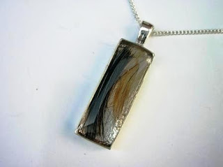 Sterling silver oblong pendant with two locks of hair