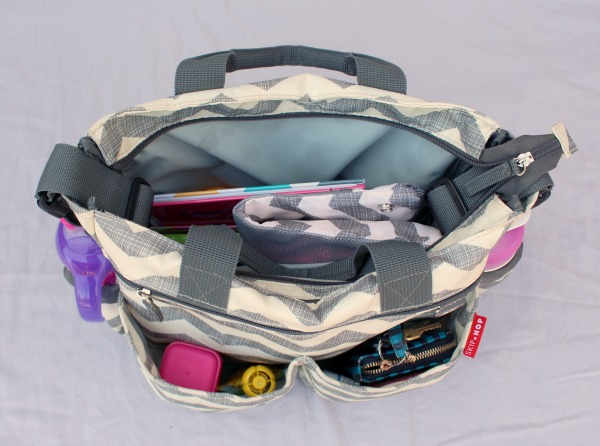 A perfectly packed diaper bag for a toddler. Grey chevron diaper bag by Hop Skip Go.