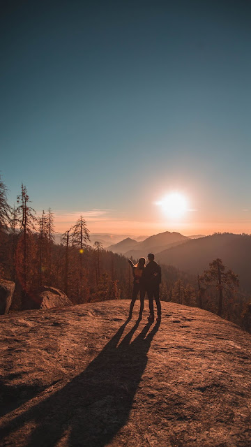 Couple in love watching the sunset together
