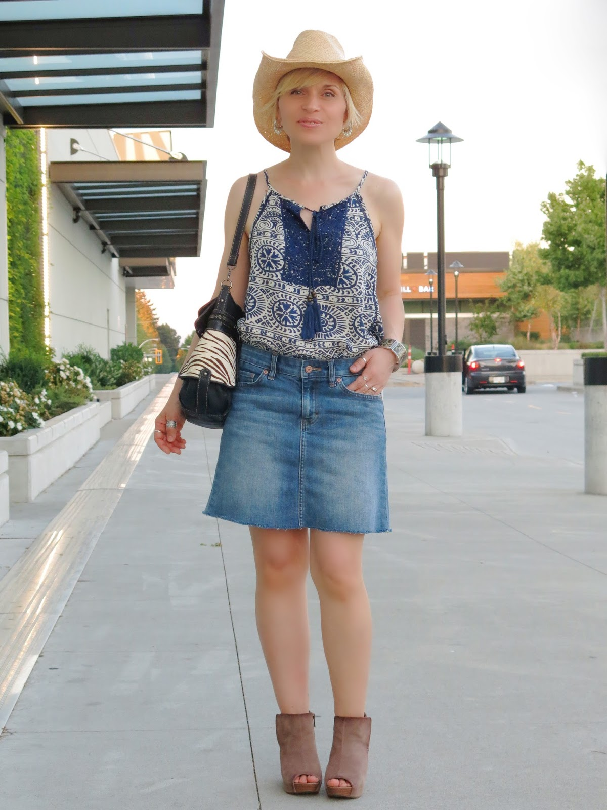 Giddy-up:  a cut-off denim skirt with a peasant tank, open-toe booties, and a cowboy hat
