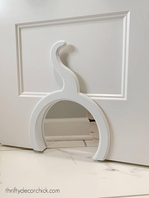 Cat shaped cat hole in door
