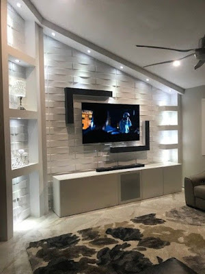 how to decorate around a tv on a large wall