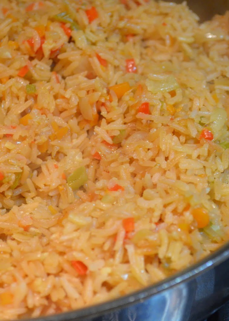 Our favorite easy recipe for Authentic Mexican Rice like you find at your favorite Mexican Restaurant using Tomato and Chicken Bouillon from Serena Bakes Simply From Scratch.