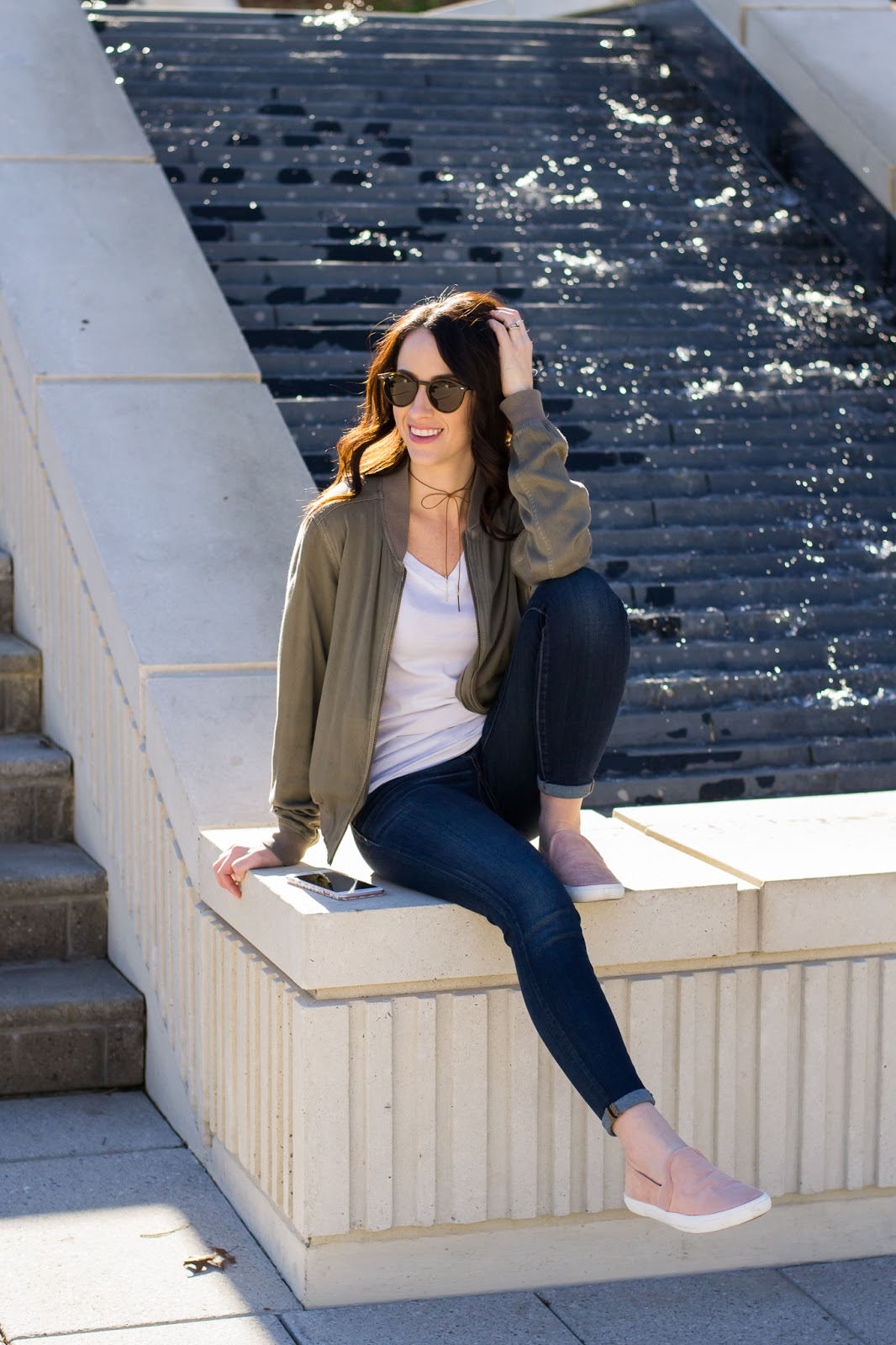 Slip on shoes paired with white tee and bomber jacket
