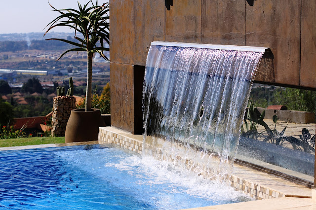 Waterfall into the swimming pool