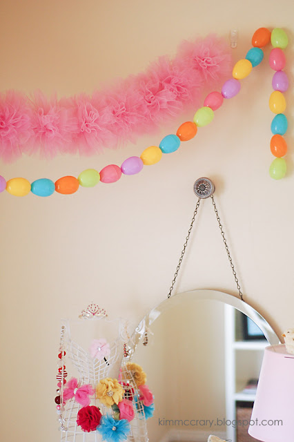 String simple DIY tulle pom poms together to create a pretty garland for any celebration.