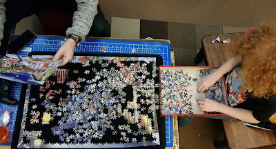 Completing a jigsaw together using puzzle mates board Jumbo Games
